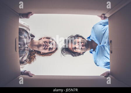 Young couple moving in into new apartment - Stock Photo