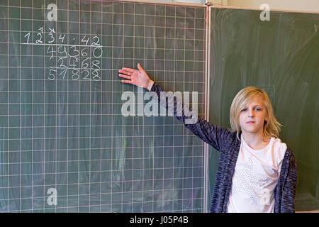 girl at primary school doing Maths, Lower Saxony, Germany - Stock Photo