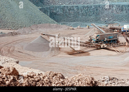 stone crusher in a quarry. mining industry - Stock Photo