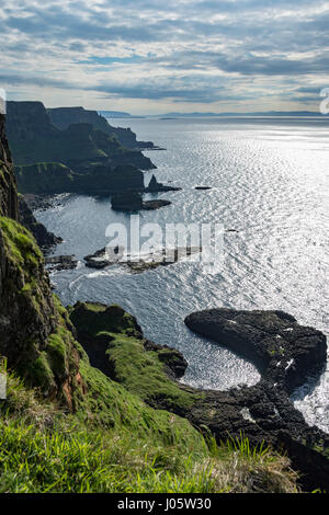 The rock feature  known as 'The Horseshoe' and cliff scenery at Port na Plaeskin, from the Causeway Coast footpath, - Stock Photo