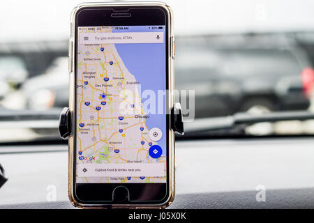 Chicago,IL,USA,Feb-21,2017,Smartphone attached to a car mount in car with Google map (for editorial use only) - Stock Photo