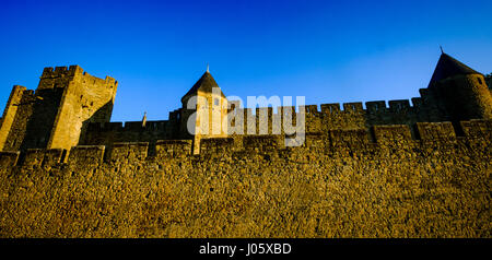 The first rays of dawn sunlight strike the walled Cité de Carcassonne, France - a UNESCO World Heritage Site - Stock Photo