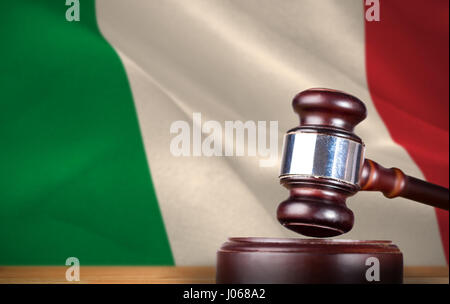Hammer and gavel against 3d digitally generated italian national flag - Stock Photo