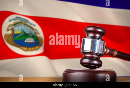 Hammer and gavel against 3d against costa rica national flag - Stock Photo