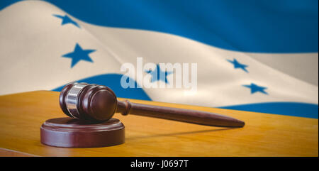 Hammer and gavel against 3d against digitally generated honduran national flag - Stock Photo