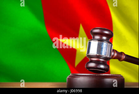 Hammer and gavel against 3d digitally generated cameroon national flag - Stock Photo