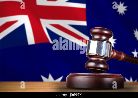 Hammer and gavel against 3d digitally generated australian national flag - Stock Photo