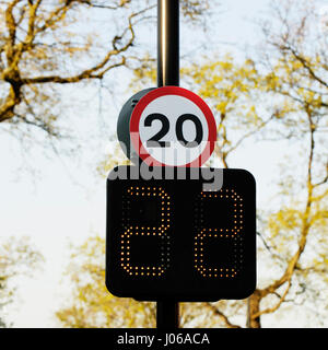 20 mph speed limit sign with speed indicator panel - Stock Photo