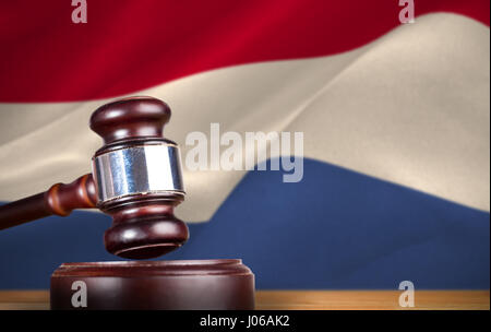 Hammer and gavel against 3d digitally generated dutch national flag - Stock Photo
