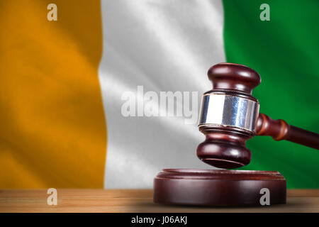 Hammer and gavel against 3d ivory coast national flag - Stock Photo