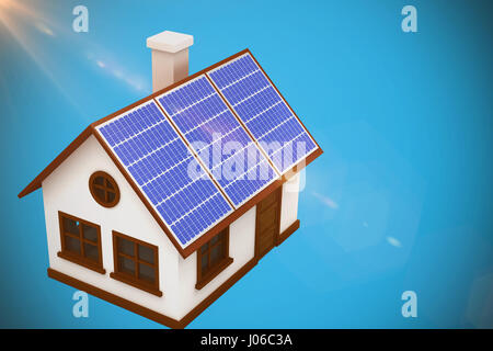 3d image of house with solar panels against blue background - Stock Photo