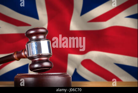 Hammer and gavel against 3d digitally generated great britain national flag - Stock Photo