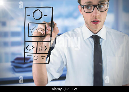 Geeky businessman writing with marker against composite image of workplace - Stock Photo