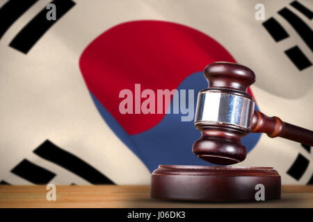 Hammer and gavel against 3d korea republic flag waving - Stock Photo
