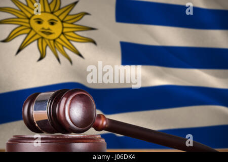 Hammer and gavel against 3d digitally generated uruguay national flag - Stock Photo