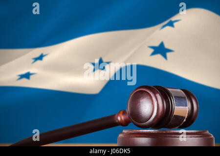 Hammer and gavel against 3d digitally generated honduran national flag - Stock Photo