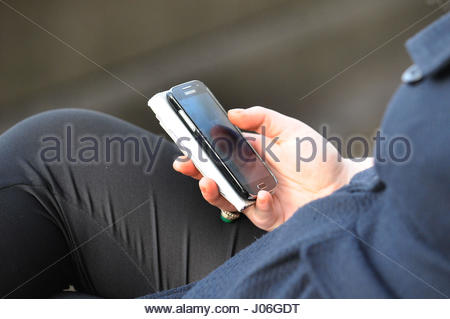 Embargoed to 0001 Tuesday April 11 File photo dated 11/10/14 of a woman using a mobile phone. Hackers are able to - Stock Photo