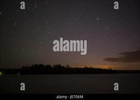Stars in sky over the lake, Lake of The Woods, Ontario, Canada - Stock Photo