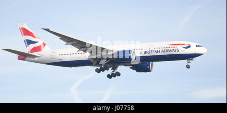 British Airways Boeing 777 G-YMMA coming into land at London Heathrow Airport LHR - Stock Photo