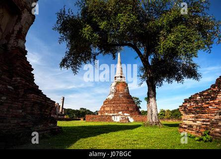 Big ruined Stupa at Wat Mahathat in Ayuttaya historical capital of Thailand - Stock Photo