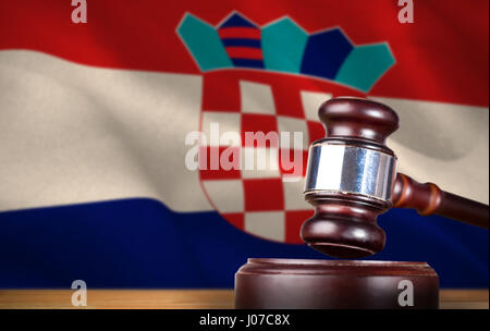 Hammer and gavel against 3d digitally generated croatian national flag - Stock Photo
