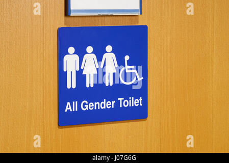 An All Gender Toilet sign on a door - Stock Photo