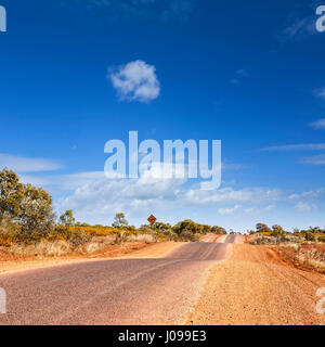This bumpy road in the desert is the Barkly Highway in outback Queensland Australia. - Stock Photo