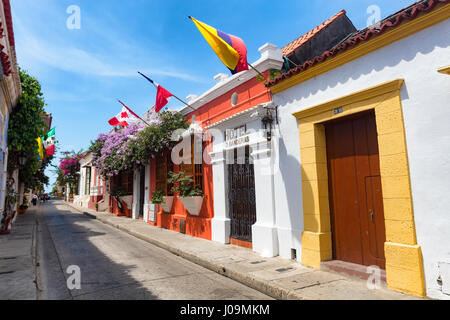CARTAGENA, COLOMBIA - MAY 23: Flags blow in the breeze on a colorful street in Cartagena, Colombia on May 23, 2016. - Stock Photo