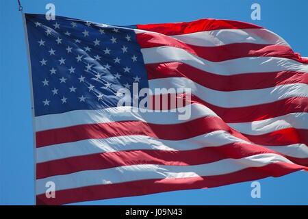 American Flag flown on the USS Midway Aircraft Carrier in San Diego Harbor - Stock Photo