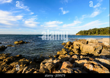 Sunset over Washerwoman's Beach, Bendalong Beach, Shoalhaven, South Coast, New South Wales, NSW, Australia - Stock Photo