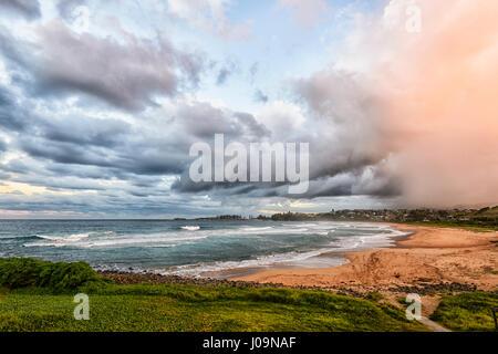 Dramatic view of an impending storm over Bombo Beach, Kiama, Illawarra Coast, New South Wales, NSW, Australia - Stock Photo