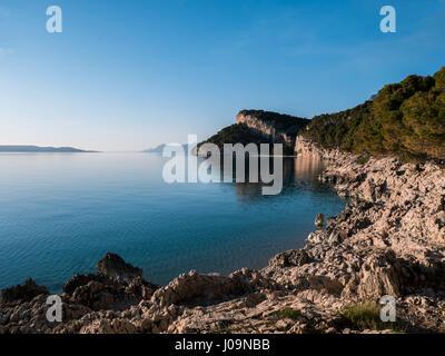 Beautiful Croatian coast on sunny day with calm blue sea - Stock Photo