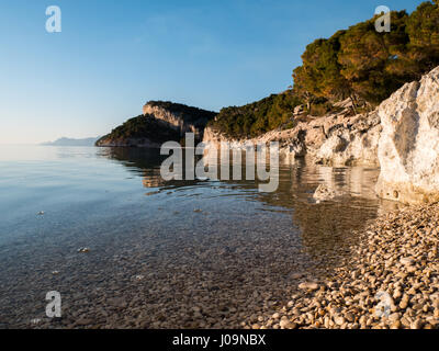 Small pebble beach and rocky coastline at Makarska riviera in Croatia - Stock Photo