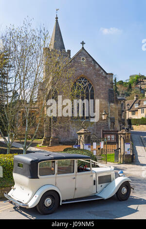 Classic wedding car outside the Holy Trinity Church Bradford on Avon, Wiltshire in April on a lovely Spring day - Stock Photo