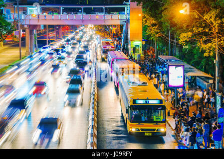 BANGKOK, THAILAND - FEBRUARY 04: Busy bus station in the Mo Chit area of Bangkok after the Chatuchak weekend market - Stock Photo