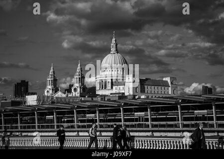Pedestrians crossing Blackfriars Bridge with St Paul's Cathedral in the background - Stock Photo