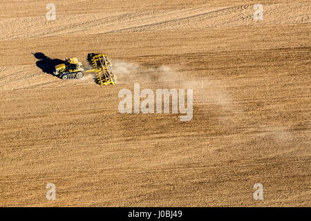 UNITED KINGDOM: A tractor at work in Kent. STUNNING aerial images show the scale of the industrialisation of the - Stock Photo