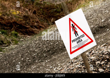 A view of a spectator safety sign on a British Motorsport forest rally event, indicating an area unsafe for spectators. - Stock Photo