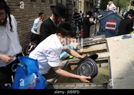 Orthodox Jews need to immerse culinary utensils in a container with mikveh or well water if they were made by Gentiles - Stock Photo