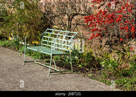 Green garden seat int he walled garden at Chadkirk country estate near Romiley, Stockport, Greater Manchester. - Stock Photo
