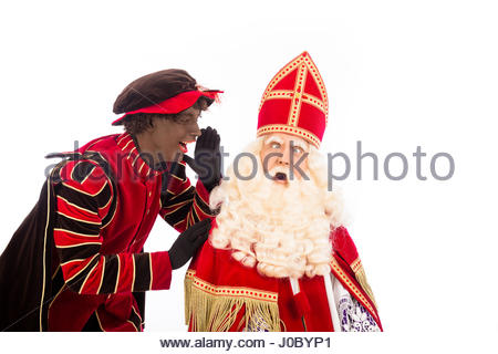 zwarte piet ( black pete) is shouting to sinterklaas . typical Dutch character part of a traditional event celebrating - Stock Photo