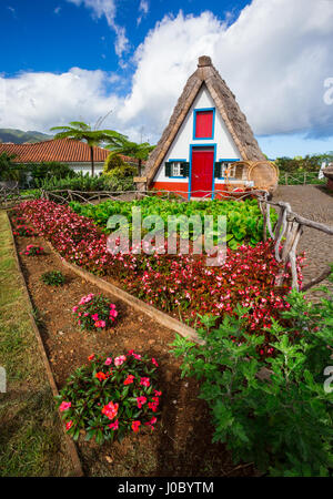 Traditional old house with thatched roof in Santana, Madeira, Portugal - Stock Photo