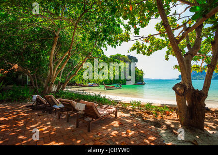 Quiet place with beach chairs to enjoy the view at Railay beach, Ao Nang, Thailand - Stock Photo
