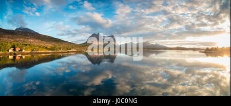 Panorama of pink clouds reflected in the clear blue sea at midnight sun, Anepollen Fjord, Nordland, Norway, Scandinavia - Stock Photo