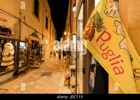 Handmade souvenirs and crafts in an alley of the old town, Otranto, Province of Lecce, Apulia, Italy - Stock Photo