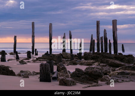 The jetty ruins at Port Willunga, South Australia at sunset. Slow shutter speed providing that smooth tranquil look - Stock Photo