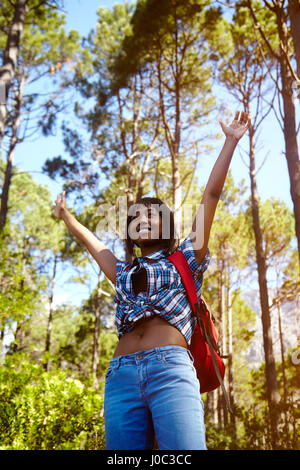 Young woman, hiking, arms raised, smiling, Cape Town, South Africa - Stock Photo