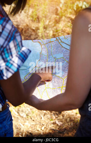 Two female friends, looking at map, rear view, Cape Town, South Africa - Stock Photo