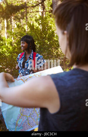 Two female friends, hiking, looking at map, Cape Town, South Africa - Stock Photo