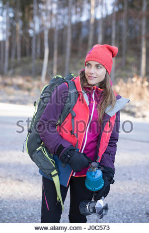 Female hiker holding camping stove in Bavarian Alps - Stock Photo